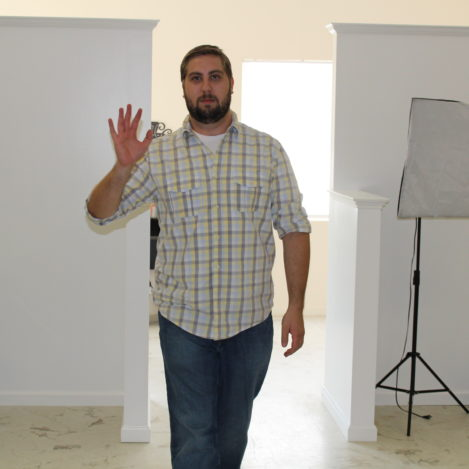 A picture of a man waving at camera.