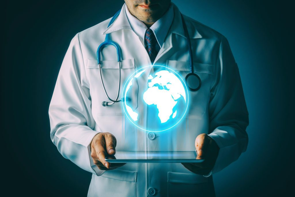 globe hologram from tablet with doctor