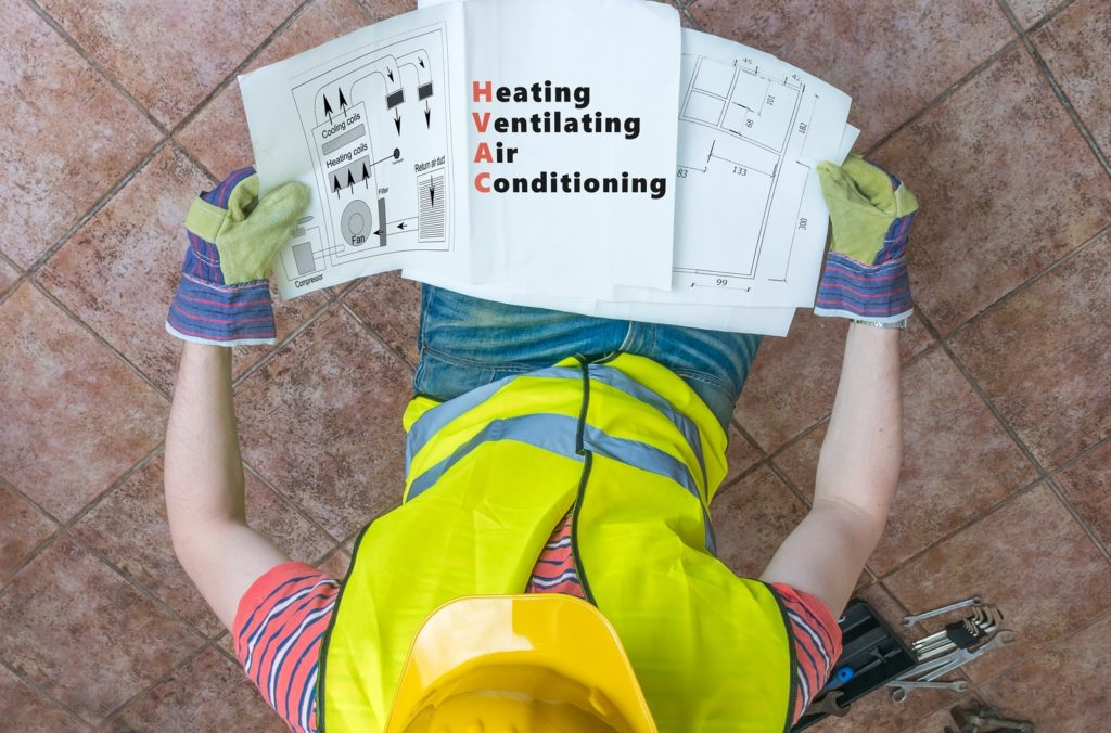 Plumber Is Looking At Documentation Of Hvac (heating, Ventilatin