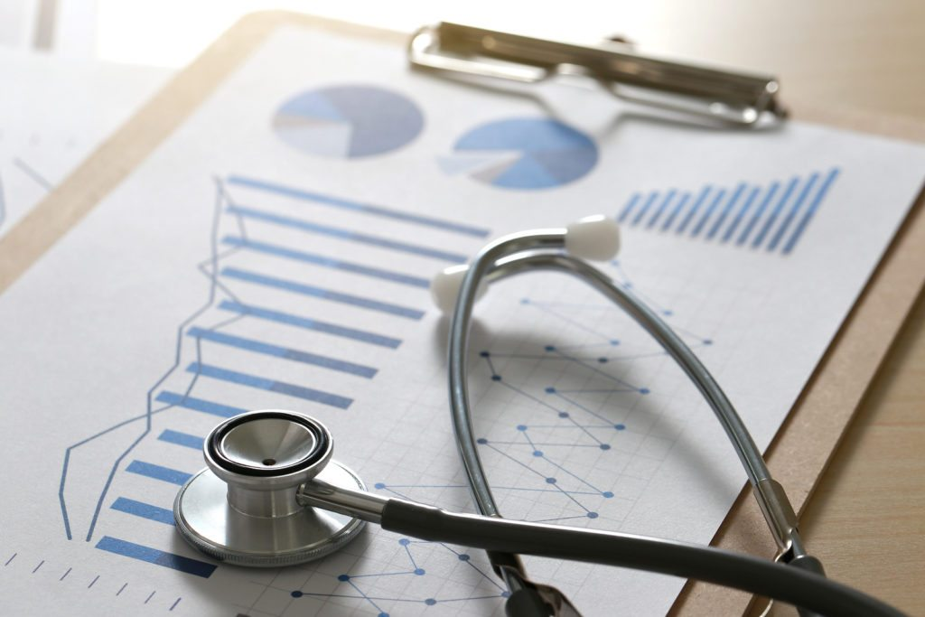 Financial Report Chart And Calculator Medical Report And Stethos