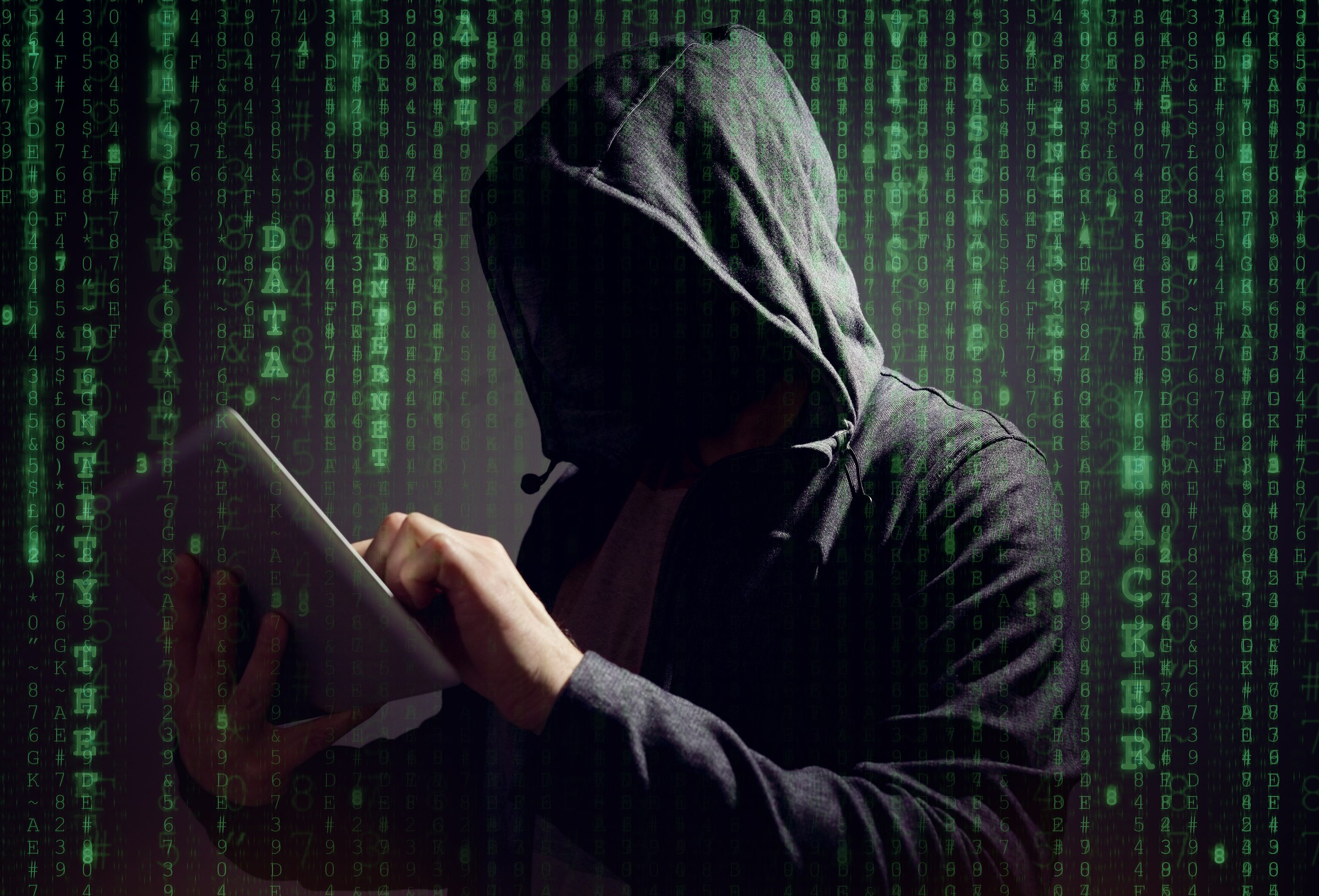 Computer hacker with digital tablet stealing data
